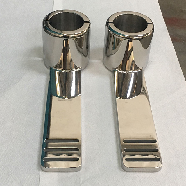 Custom made stainless steel stand-up paddle board brackets.